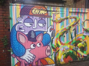 This portrait of a pig is on a wall off brick lane.