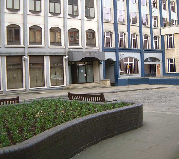 Looking diagonally left across Mitre Square towards the arch in 2003.