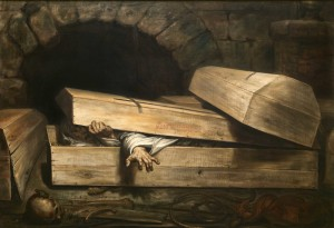 A prson tries to get out from a coffin