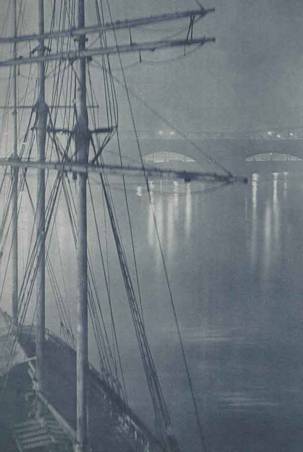 The mast of a ship seen in a fog on the River Thames.