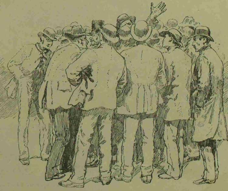 Men listening to a speaker in the square.