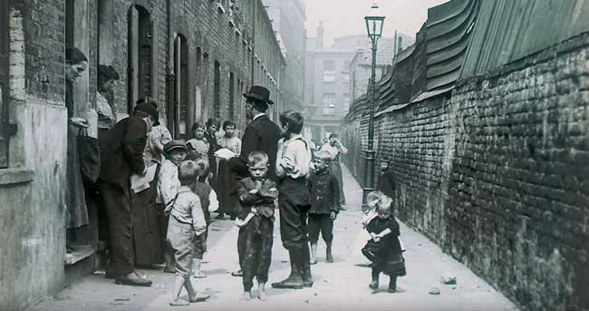 A look into an slum alley of Victorian London.