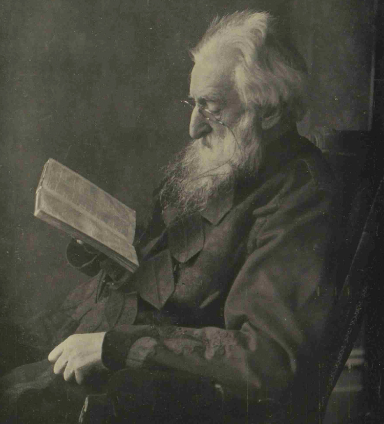A photograph showing General Booth reading a book.